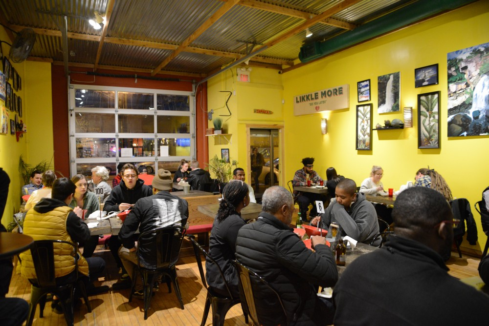 Customers enjoy their meals on Saturday, March 23 at Pimento Jamaican Kitchen in Minneapolis.