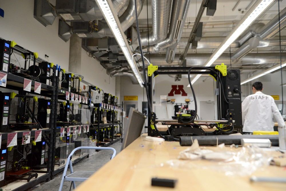 A 3D printer that is being worked on sits on a table on Monday, March 25 at the Anderson Student Innovation Labs in the Mechanical Engineering Building on East Bank. The lab is a