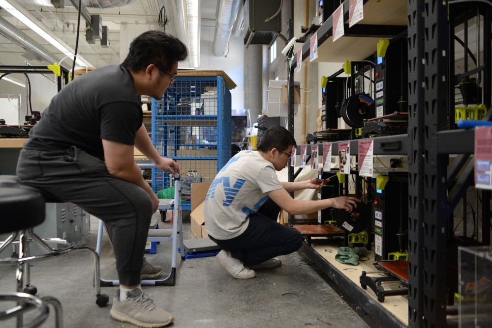 Tonghu Han and Enci Lin work on printing a film cooling structure on Monday, March 25 at the Anderson Student Innovation Labs in the Mechanical Engineering Building on East Bank. The lab is open to all students.