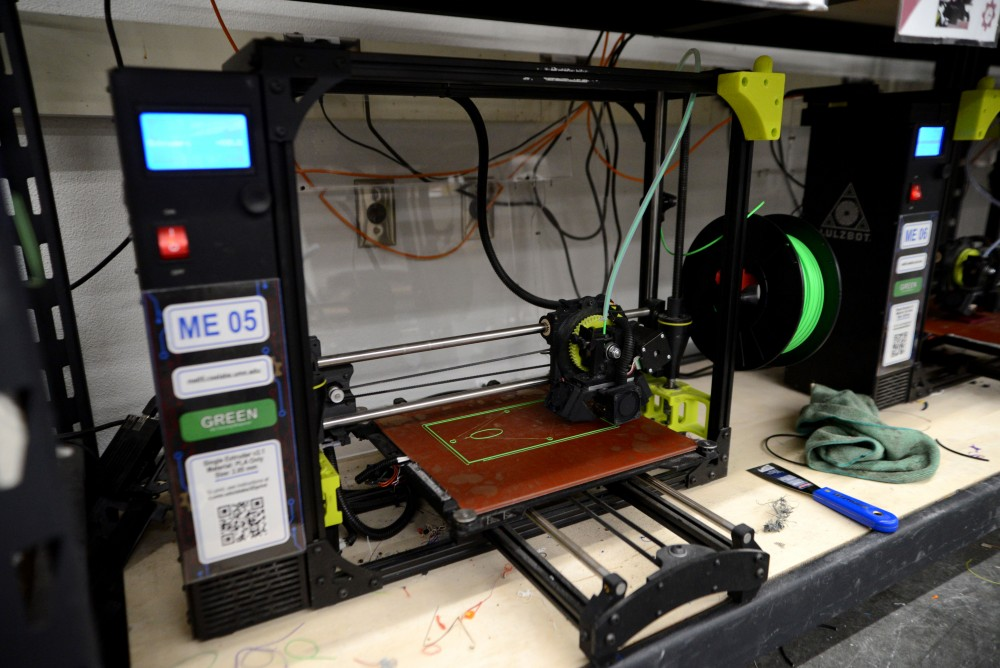 A 3D printer prints a student project on Monday, March 25 at the Anderson Student Innovation Labs in the Mechanical Engineering Building on East Bank.
