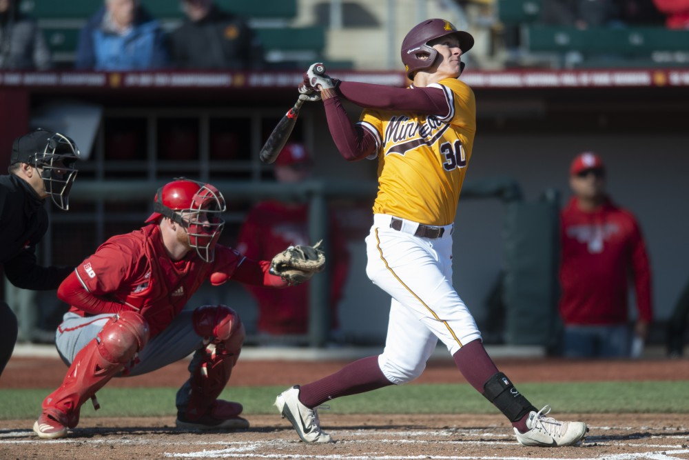 Infielder Jack Wassel watches his hit at Siebert Field on Friday, March 29, 2019.