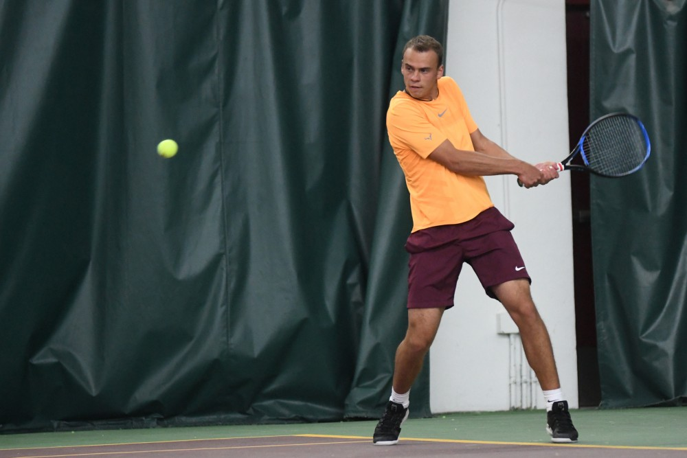 <p>Sophomore Vlad Lobak prepares to return the ball on Friday, March 22 at the Baseline Tennis Center.</p>