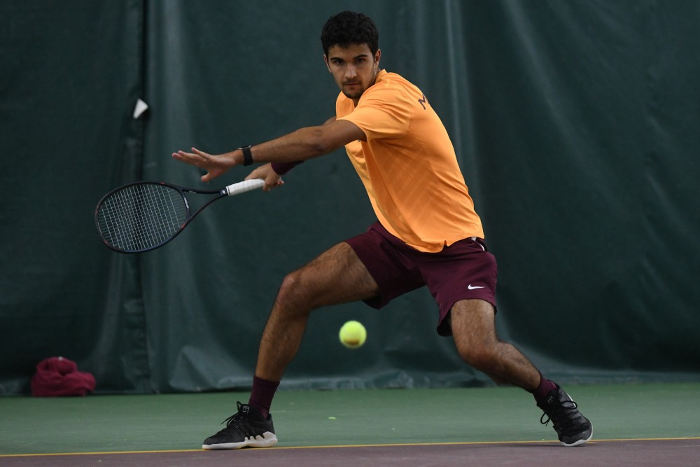 Senior Josip Krstanovic competes in his singles match on Friday, March 22 at the Baseline Tennis Center.