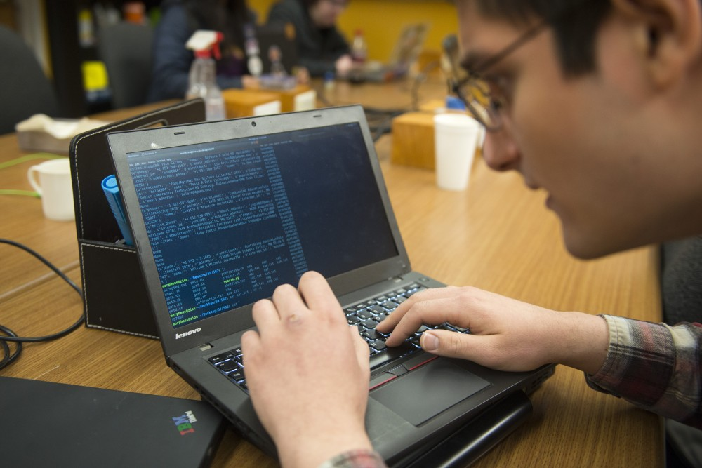 Electrical engineering sophomore Sina Roughani operates a terminal that he uses to capture recorded data from the University's
