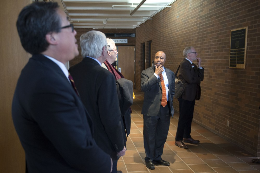 Dean Garry Jenkins gives a tour of the Law School in Mondale Hall during the Board of Regents' West Bank professional programs visit on Thursday, March 7.