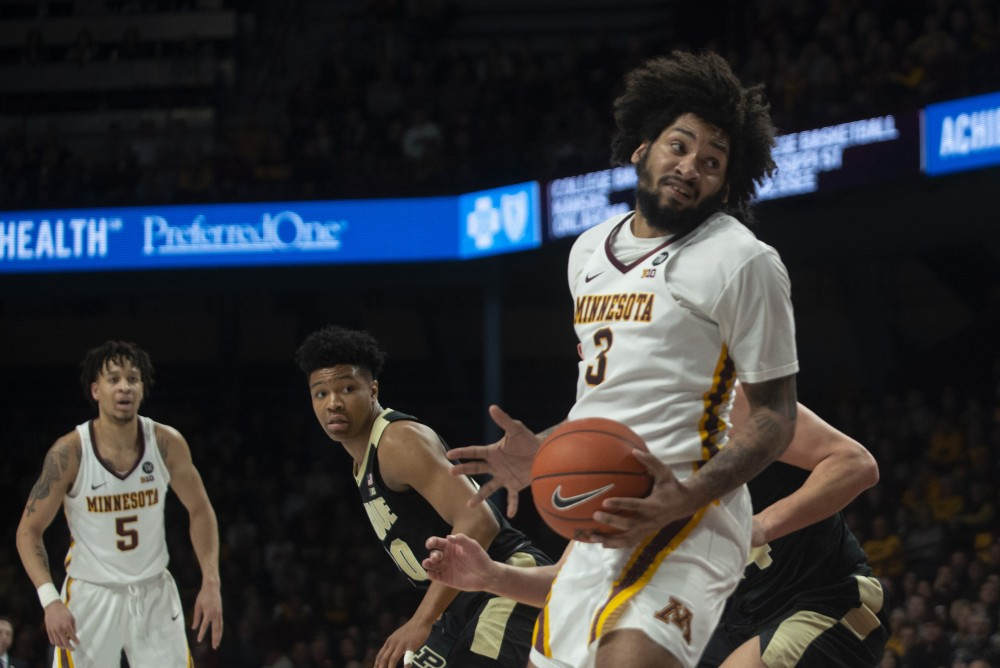 <p>Senior Jordan Murphy spins towards the basket on Tuesday, March 5 at Williams Arena.</p>