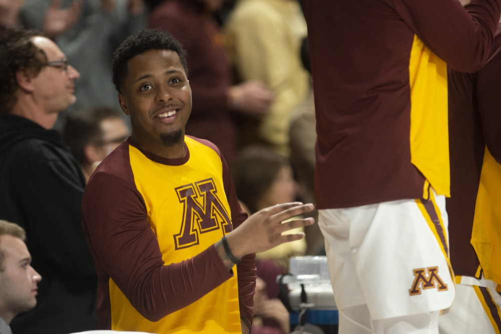 Senior Jarvis Johnson watches the game at Williams Arena on Tuesday, March 5.