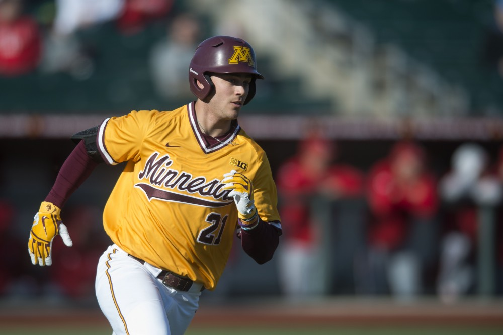 Outfielder Drew Hmielewski runs for first base at Siebert Field on Friday, March 29. Eli Wilson's home run in the bottom of the tenth inning lead the Gophers to a 5-2 win over Nebraska.