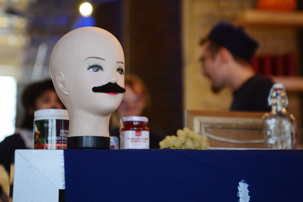 A mannequin head wearing a mustache sits on top of the bar at the Weird Shit Art Show on Sunday, March 31 at A-Mill Artist Lofts in Minneapolis.
