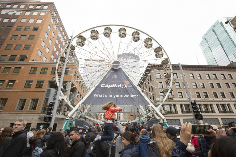 Fans wait in line to ride the Ferris wheel on Nicollet Mall during the Tip-Off Tailgate on Friday, April 5.