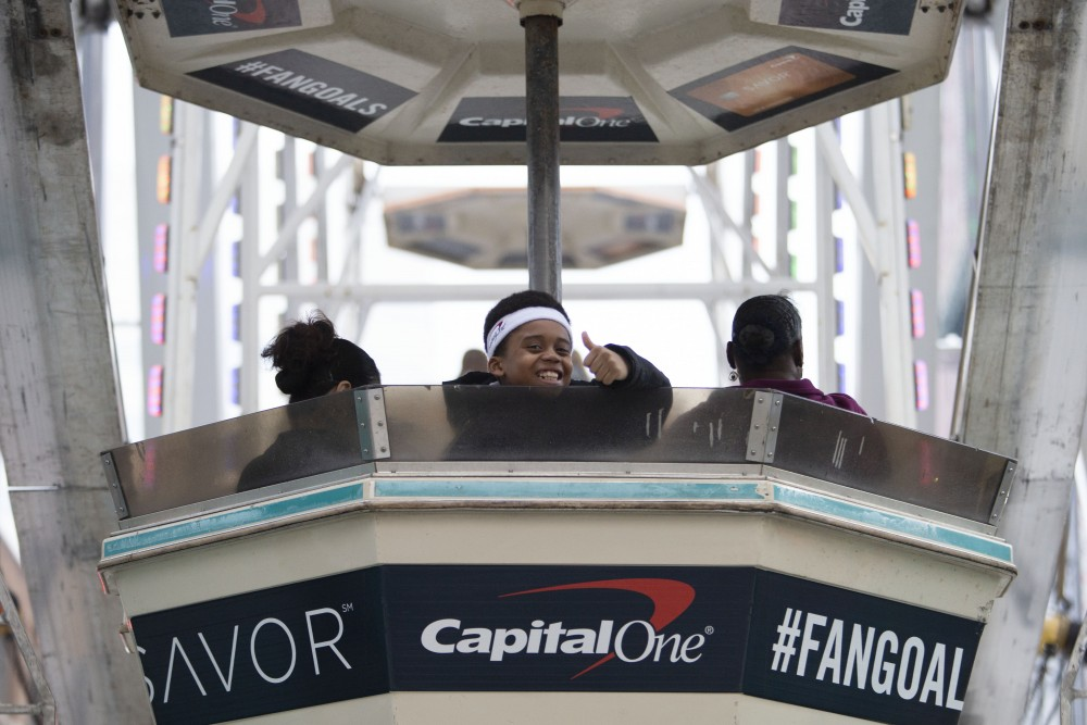 Final Four attendees ride the Ferris wheel on Nicollet Mall on Friday, April 5.