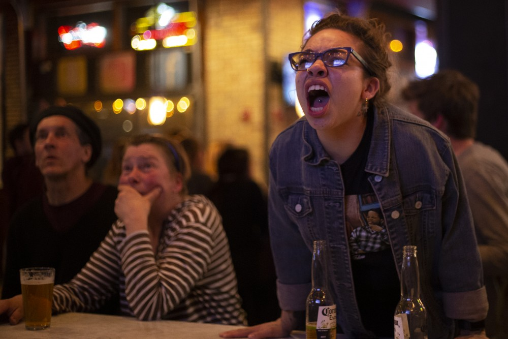 Traymarah Scott, an off-duty Sally's Saloon employee and University of Minnesota student, screams for Texas Tech during the NCAA Final Four Championship game at the Stadium Village bar and eatery on Monday, April 8. Virginia defeated Texas Tech 85-77 in overtime.