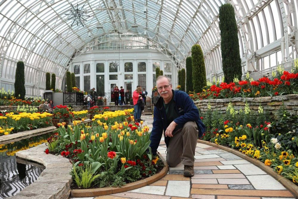 Horticulturist Paul Knuth poses for a portrait at the Como Park Zoo & Conservatory on Thursday, April 4. We can grow it right here and then I can see 1,000 people coming in enjoying it, so its very rewarding, Knuth said of his job at the conservatory.