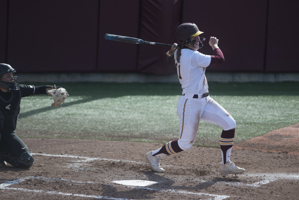 Freshman Natalie Denhartog hits the ball on Friday, March 29 at Jane Sage Cowles Stadium in Minneapolis. The Gophers beat the Purdue Boilermakers 5-1.