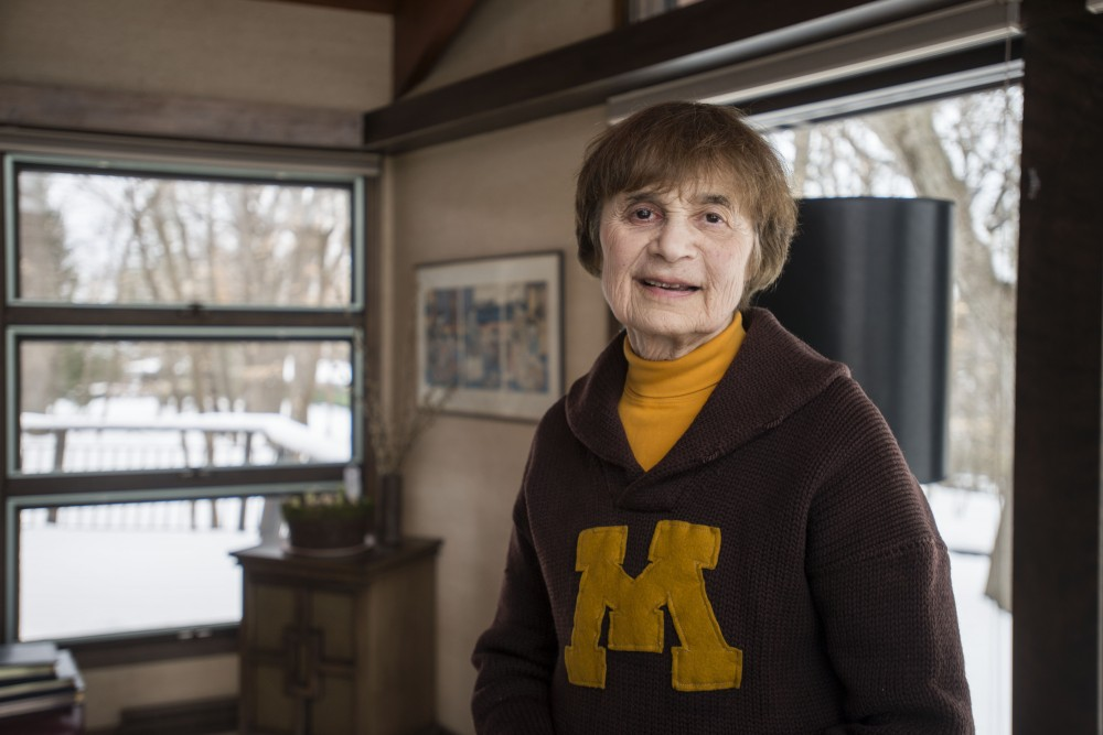 <p>University Regent Linda Cohen poses for a portrait on Saturday, April 13 in her home in Minnetonka. The cardigan she is wearing was her father, Louis Gross' from his time at the University in the 1920s.</p>