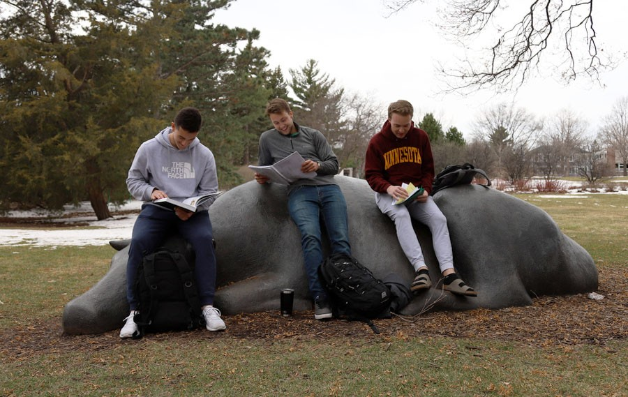 Mitch Van Sickle, Tommy Leitner and Colin Leuthold work on a group project outside to get some fresh air on St. Paul campus on Monday, April 15.