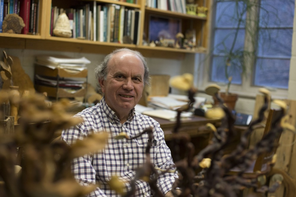 Robert Blanchette, a professor in the Department of Plant Pathology, poses for a portrait on Wednesday, April 17 in his office in Stakman Hall on the St. Paul campus. Blanchette studies forest pathology and wood microbiology, which sparked an interest in mycology. His office is filled with a collection of preserved fungi.