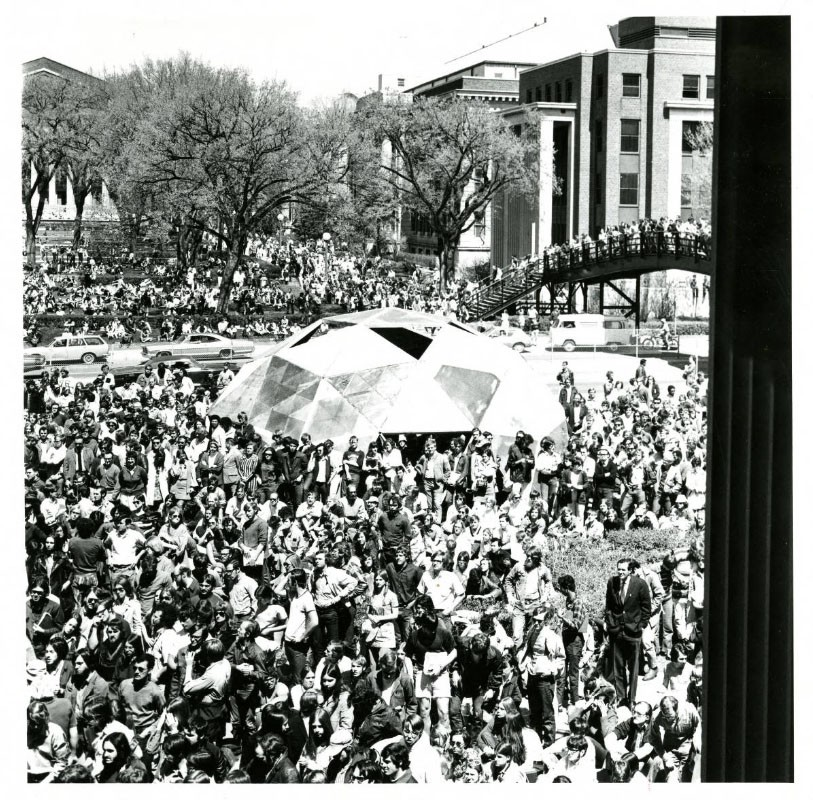 Inventor Buckminister Fuller spoke at Coffman Union for Earth Week 1972. Attendance at his speech was so high students spilled out onto the mall. Fuller invented geodesic domes, which are energy efficient building structures. A geodesic dome (featured in this photo) was constructed on campus for him (according to Ed Finale, a man who helped organize Earth Week 1972 as a student).
