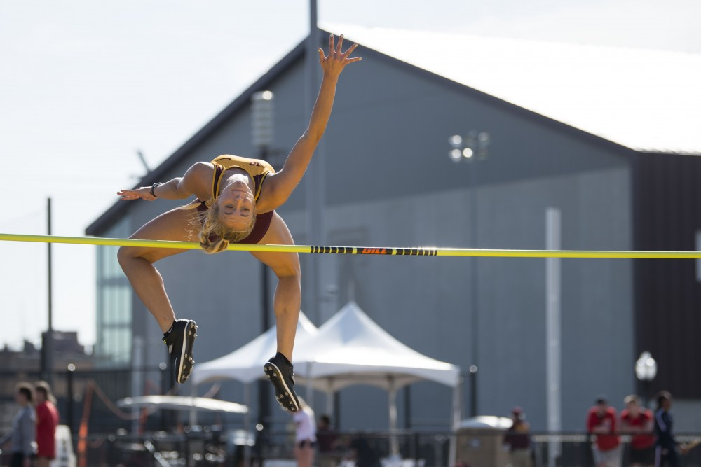 Sophomore Hannah Arason performs the high jump at the Minnesota Track & Field Stadium in Minneapolis for the Gopher women's Twilight Meet on Wednesday, April 24.