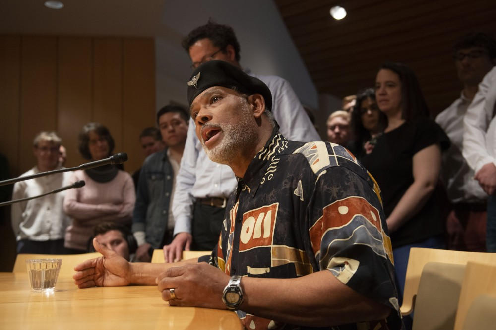 <p>Professor John Wright faces the Board of Regents after receiving support from the crowd during the special session on Friday, April 26, 2019. The board voted against the renaming of four buildings on campus after more than a year of community discussion on the issue. </p>