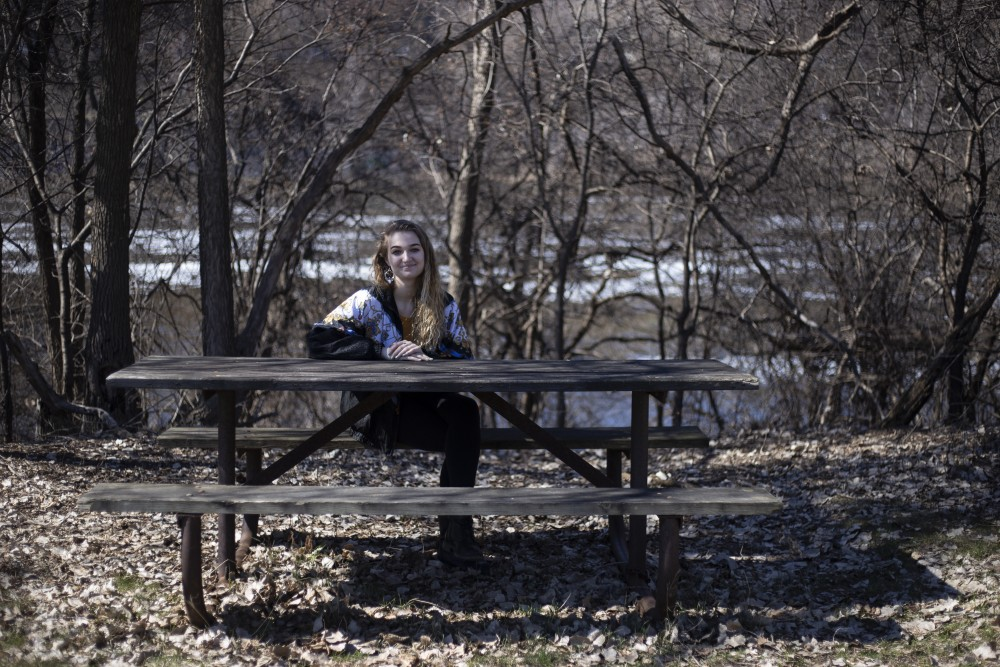 Sophie O'Rourke poses for a portrait near the Mississippi River on Friday, April 19. O'Rourke, who has fibromyalgia and identifies as a person with an invisible disability, used the space to decompress after her summer job at Comstock Hall.