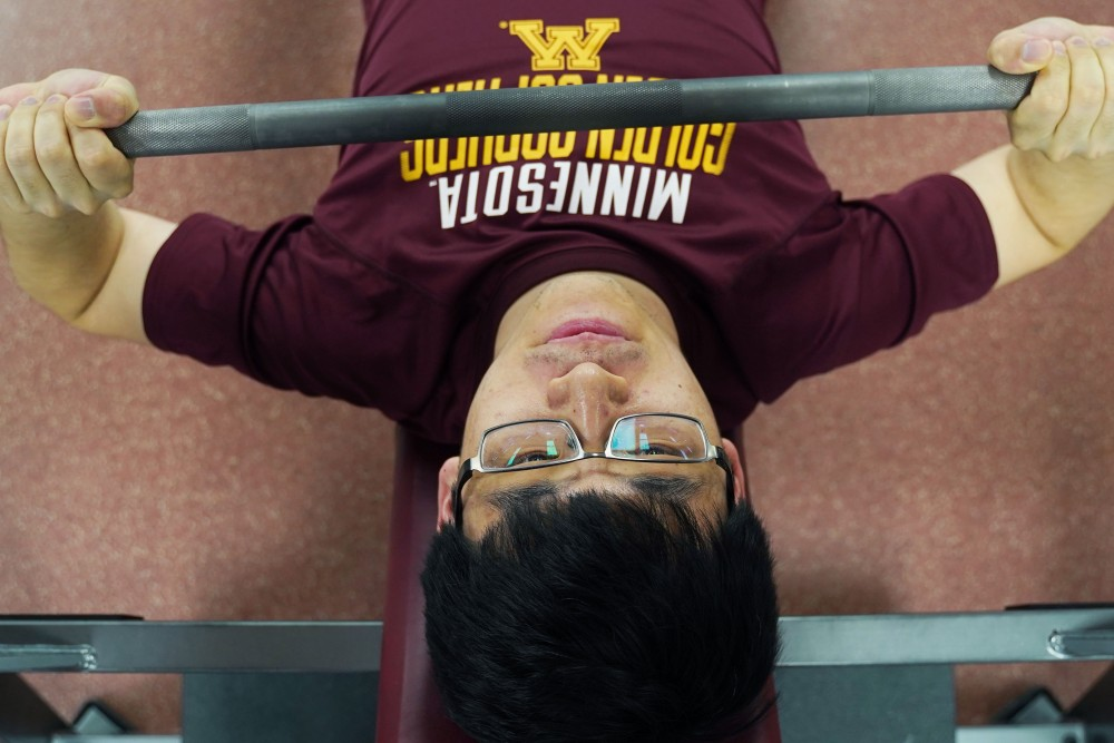 Council of Graduate Students President Sean Chen works out at the University Recreation and Wellness Center on Monday, April 29.