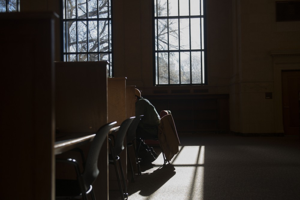 9:36 a.m. A student studies on the second floor of Walter Library.