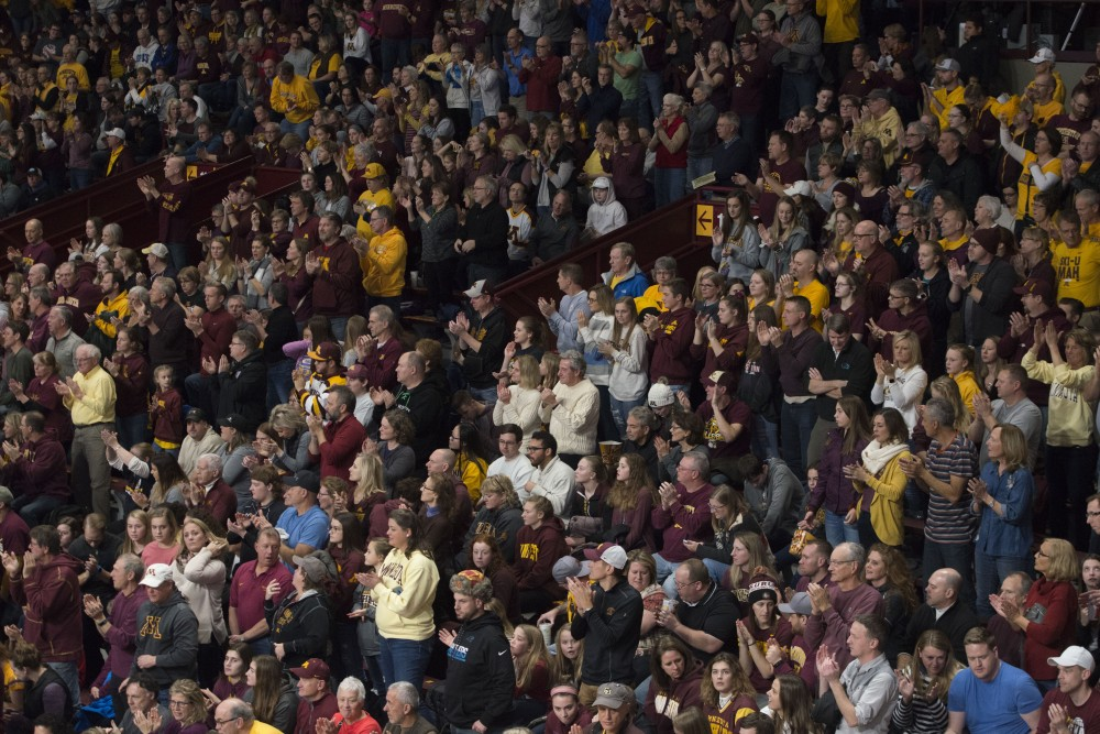 Fans cheer on Gopher volleyball on Dec. 1, 2018 at Maturi Pavilion in Minneapolis.