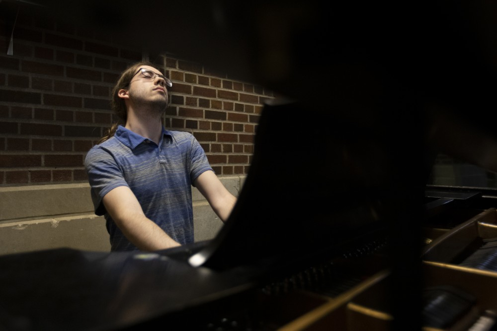 9:44 p.m. Computer engineering junior Owen Hoffend leans into a song he composed as he plays on the piano at Coffman Union. Hoffend has been playing piano since fifth grade and comes to Coffman to practice as often as possible.
