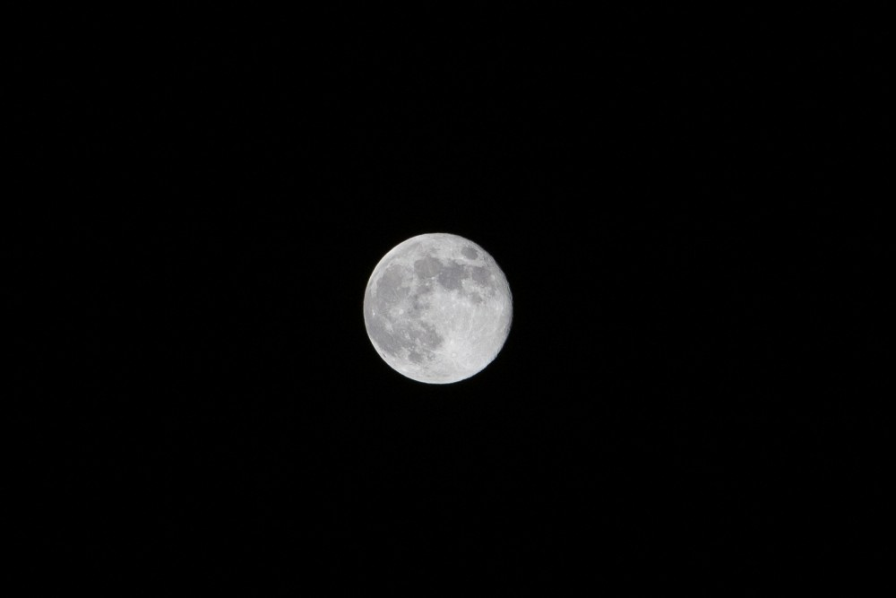 11:59 p.m. The full moon glows just before the night becomes the morning of April 21, 2019.