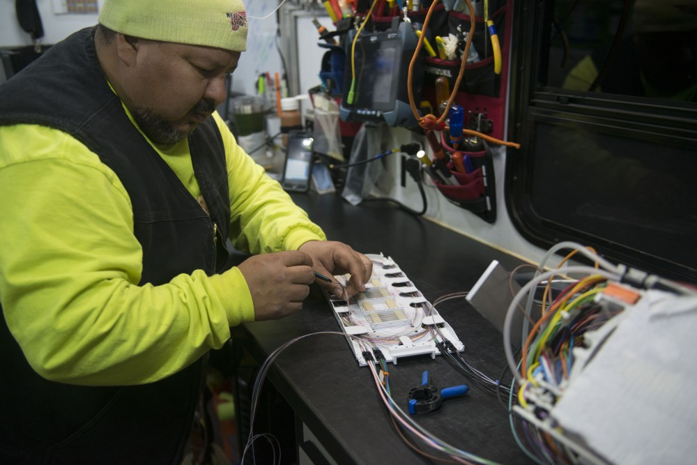 3:08 a.m. A utility worker handles a confidential telecommunications project at the corner of 11th Ave and 6th St SE.