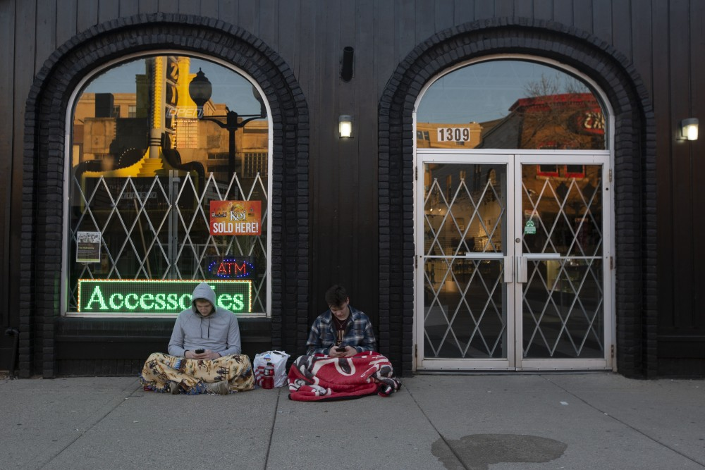 6:55 a.m. Two anonymous students wait for Hideaway to open so they can take advantage of the 4/20 holiday sales a day early.