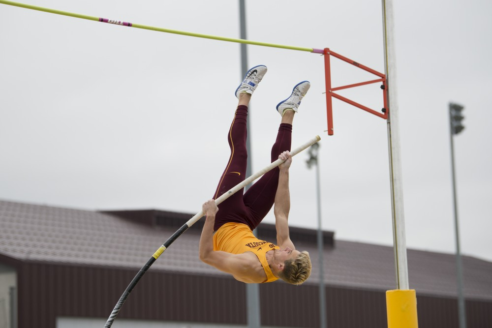 Junior John Uchytil vaults on Wednesday, May 1 at the men's track Twilight Meet at the Minneapolis Track and Field Stadium.
