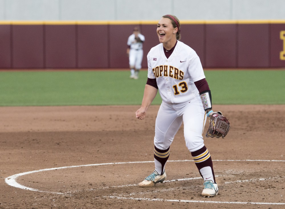 Pitcher Amber Fisher celebrates after a strike out at Jane Sage Cowles Stadium against Northwestern on Friday, May 3, 2019.