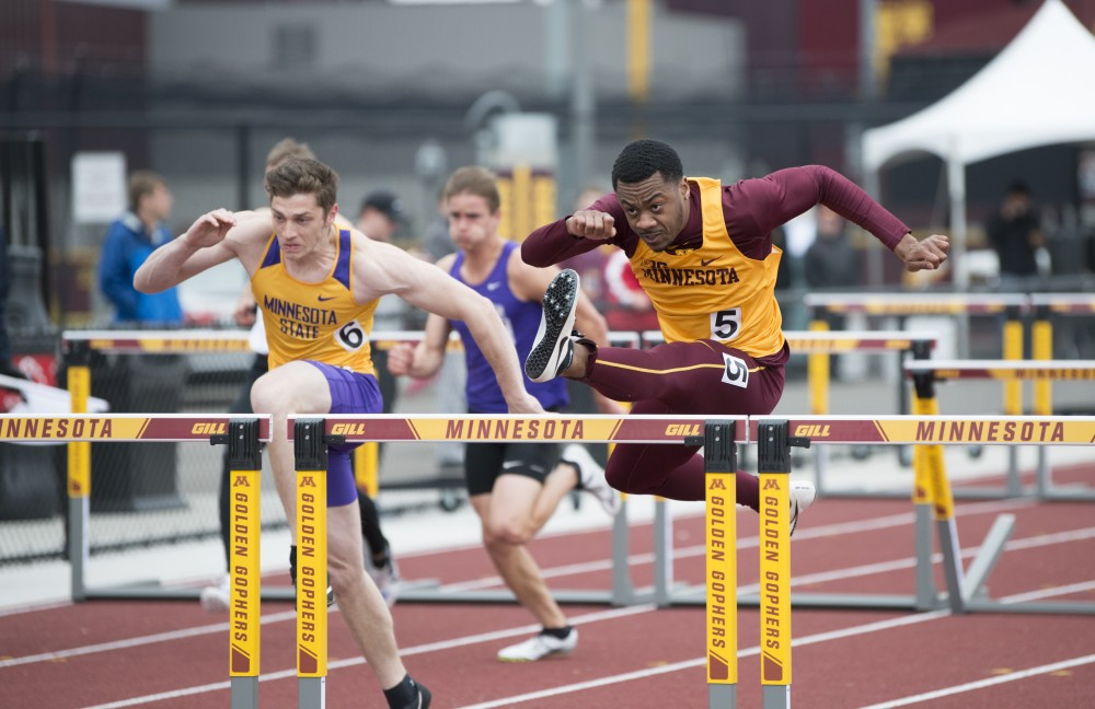Junior Eric Walker hurdles on Wednesday, May 1, 2019 at the Mens track Twilight meet at the Minneapolis Track and Field Stadium.