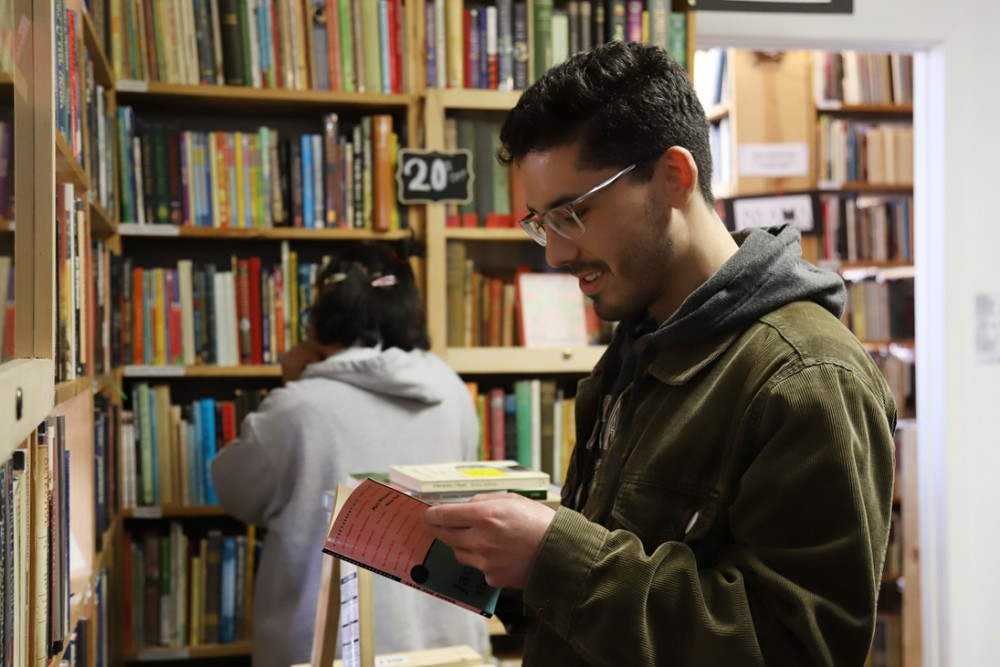 Alex Pieczynski and Kathy Patino browse the shelves of The Book House on Thursday, May 2 2019. Pieczynski and Patino are members of Chicago band