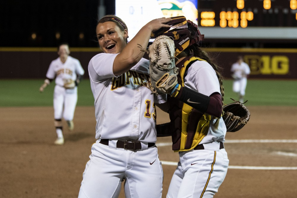 Pitcher Amber Fiser and catcher Emma Burns celebrate striking the Bison out on Friday, May 17, 2019 at Jane Sage Cowles Stadium in Minneapolis. The Gophers beat North Dakota State University 3-0.