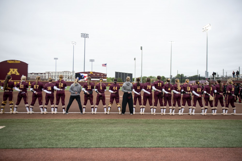 The Gopher softball team stands during the national anthem on Saturday, May 18 at the Jane Sage Cowles Stadium in Minneapolis. The Gophers beat the University of Georgia 2-1.