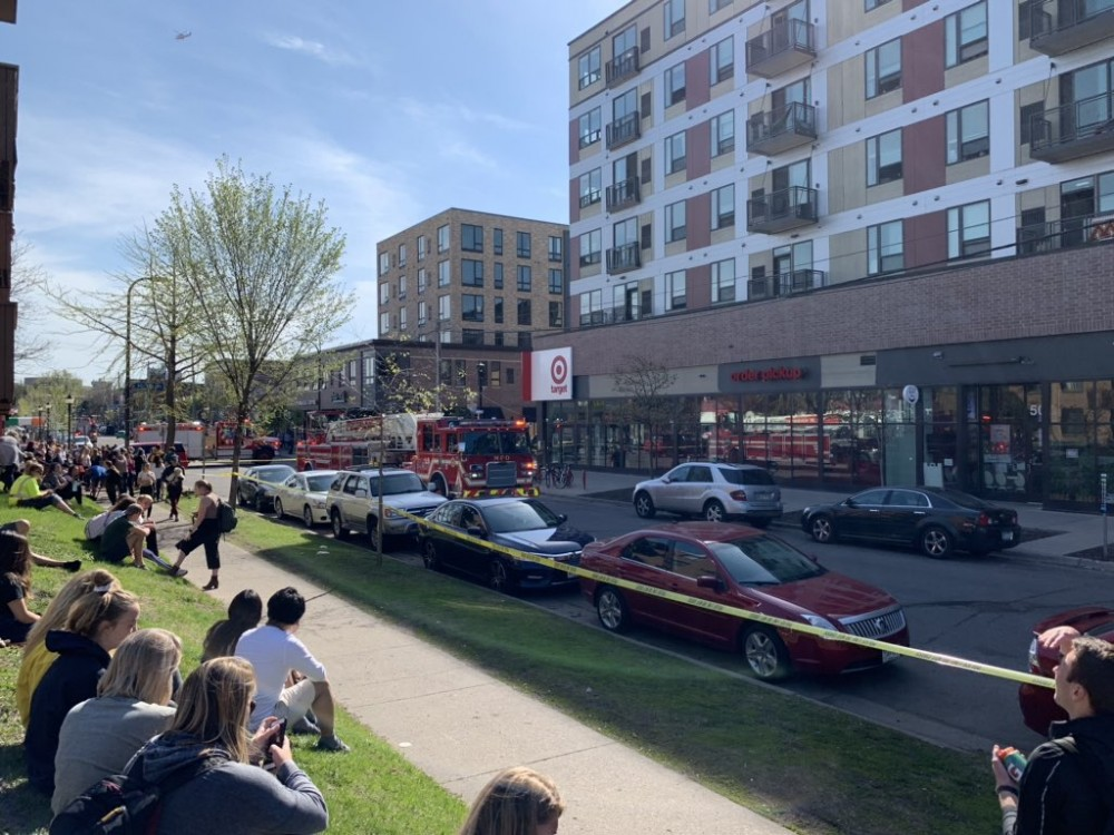 Residents wait outside The Marshall apartments in Dinkytown on Tuesday, May 7 as fire fighters respond to an unconfirmed report of ricin in the building.