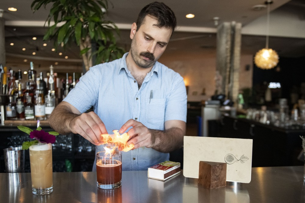 Head bartender Tyler Allen prepares one of his signature drink