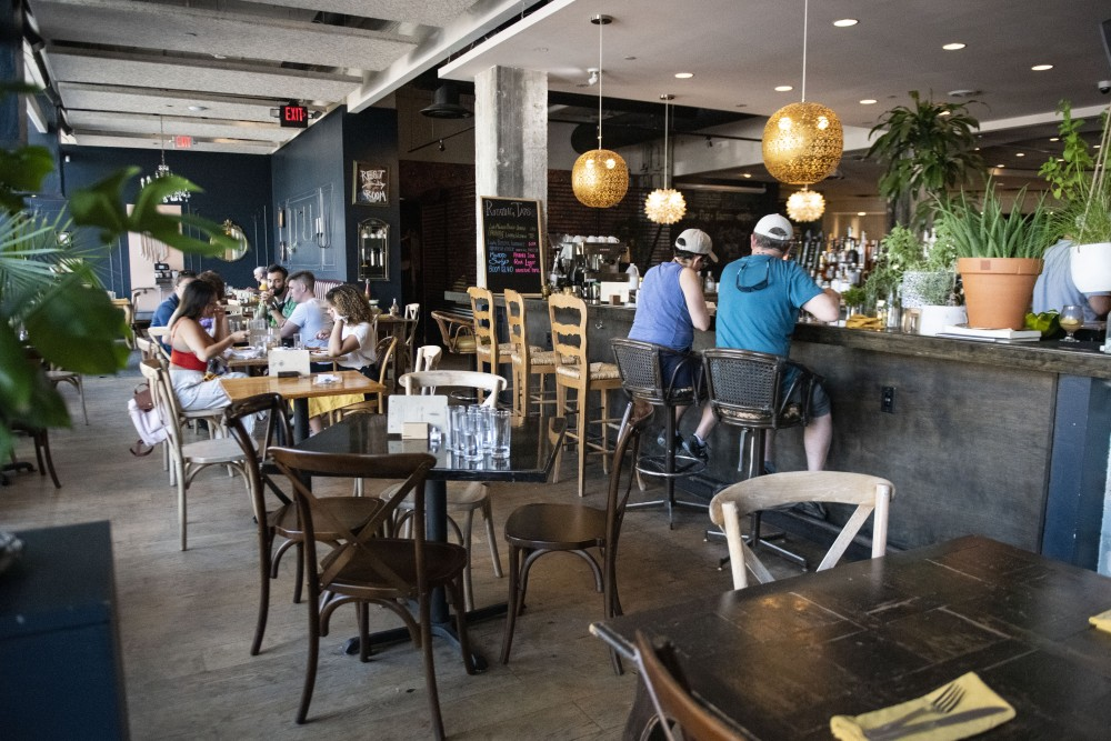 People sit in Fig + Farro on Saturday, June 8 in Uptown.