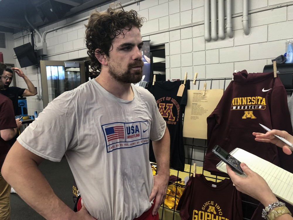 Former Gopher wrestling Pat Smith talks to the press about Olympic qualifications on Friday, June 14 at Bierman Field Athletic Building in Minneapolis.