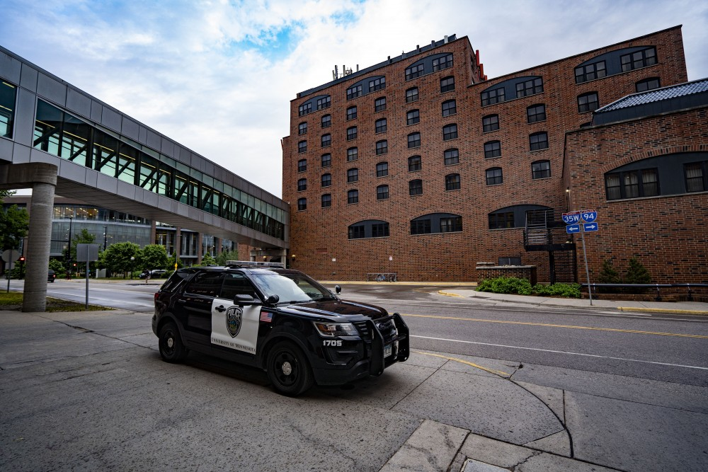 A University of Minnesota Police car is parked outside of the Graduate Hotel on East Bank  on Thursday, June 21.