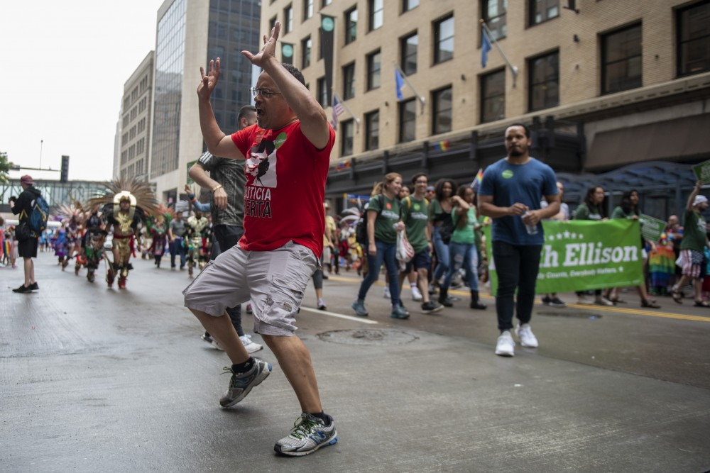Minnesota Attorney General Keith Ellison cheers with parade goers on Sunday, June 23 in downtown Minneapolis