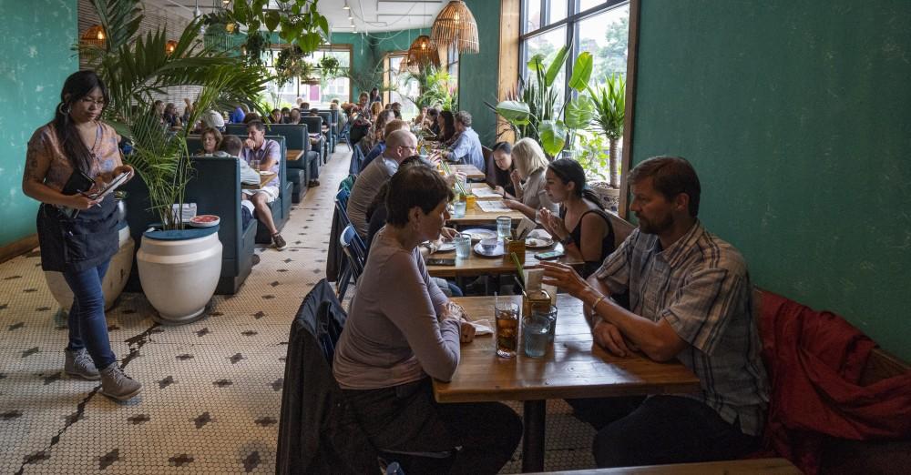 Patrons fill the restaurant during dinner at Hai Hai in Minneapolis on Sunday, June 23.