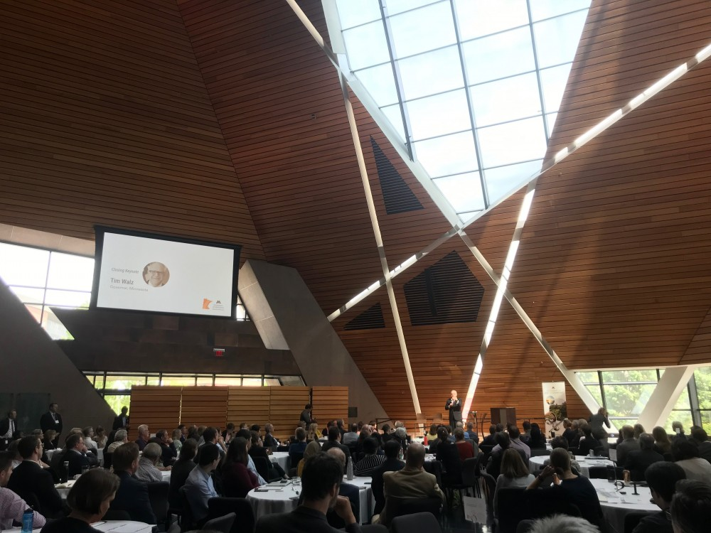 Attendees listen as Gov. Tim Walz discusses clean energy at McNamara Alumni Center on Friday, June 14.