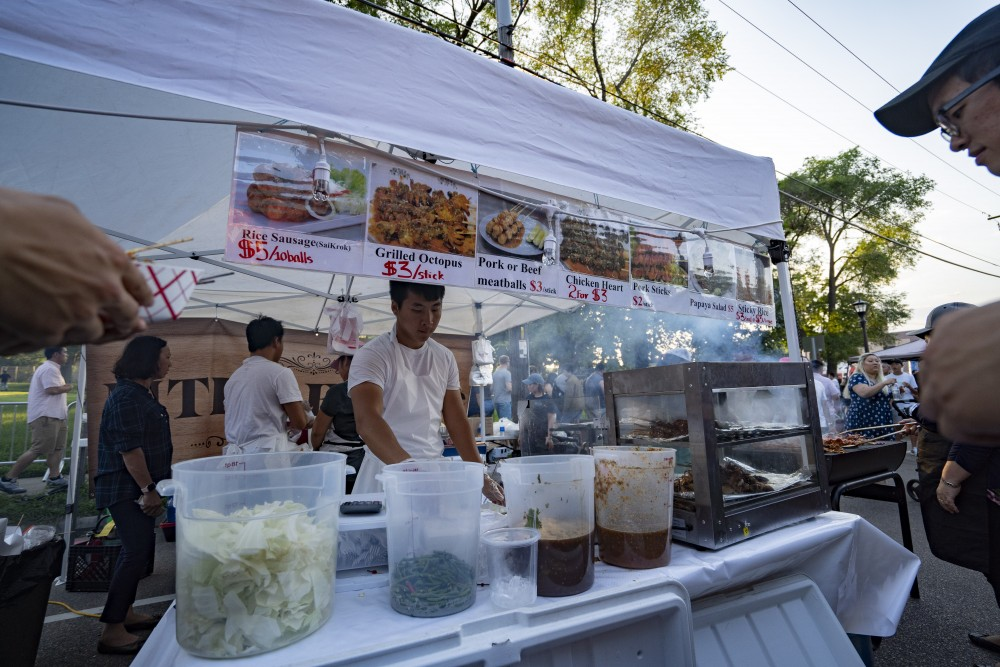 A street vendor sells Southeast Asian foods on Saturday, July 6 in St. Paul for the annual Little Mekong Night Market.