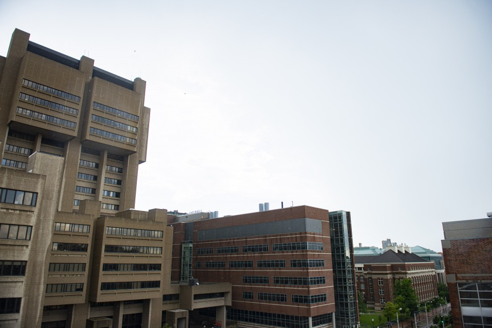 University Medical School buildings are seen from Washington Avenue during a rain storm on Tuesday, July 16.