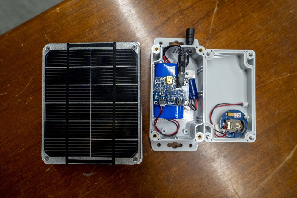 The solar panel and Bluetooth receiver for an app that Chen-Fu Liao, a researcher at the Center for Transportation Studies, is creating to help the visually impaired navigate streets in the Mechanical Engineering building on Wednesday, July 17.