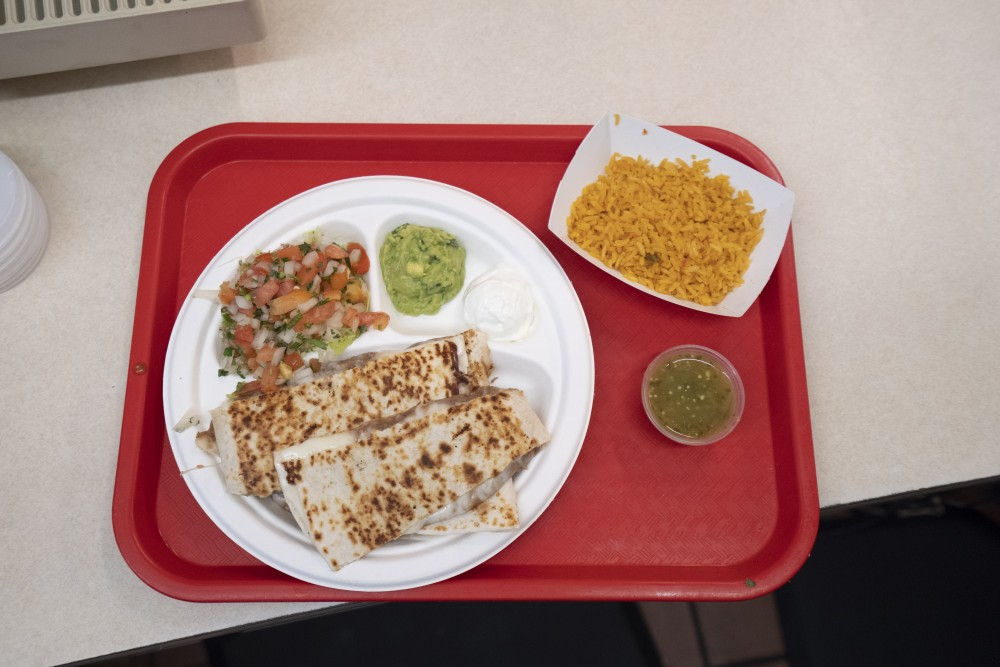 Quesadillas are ready at El Taco Riendo on Central Avenue in Minneapolis on Friday, July 19.
